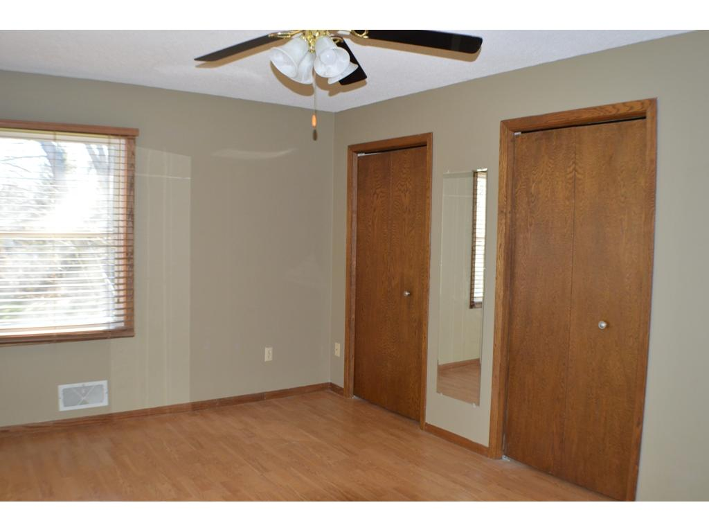 Master with double closets and ceiling fan.