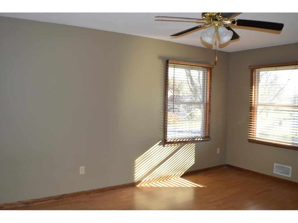 Master also has hardwood flooring and two bright windows.