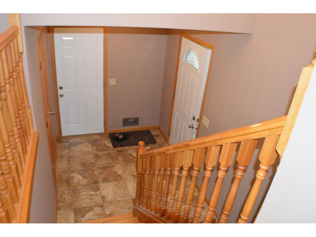 View of large entryway with ceramic tile.  Features a large walk-in closet with more than enough room to store coats, mittens and boots that are needed during our Minnesota winters!