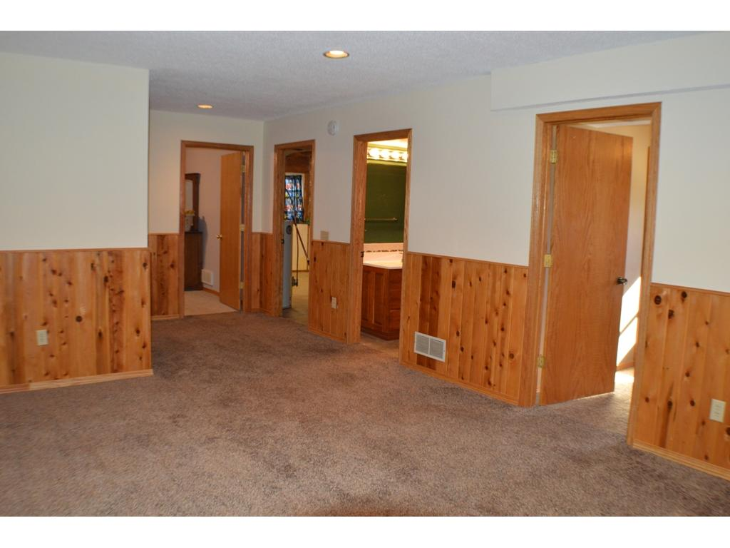 Family room also includes knotty pine wainscotting that extends into the hallway.