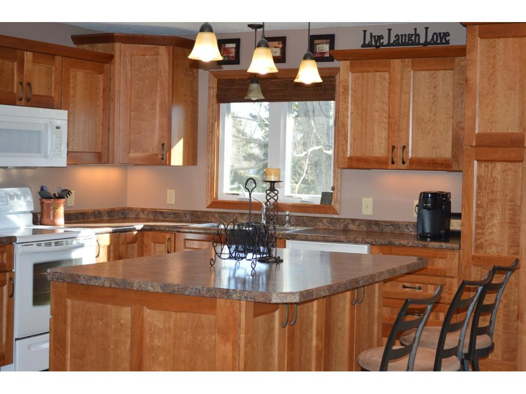 The new kitchen is a cooks dream with oversized center island, custom cabinetry and ceramic tile flooring!
