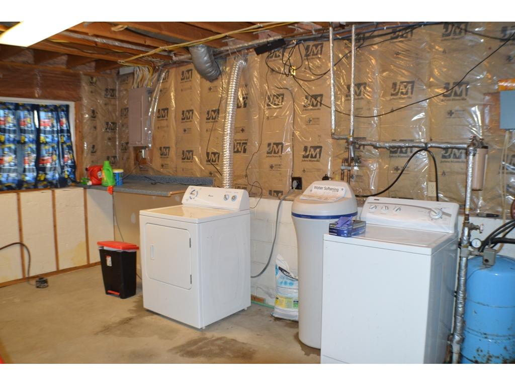 Spacious laundry and mechanical area of the home.
