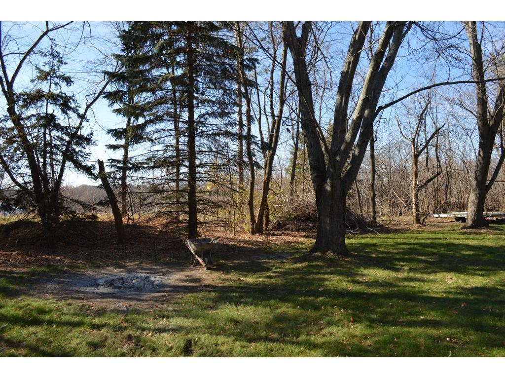 Large .57 acre lot with mature trees!  Great neighborhood with Forest Lake nearby!