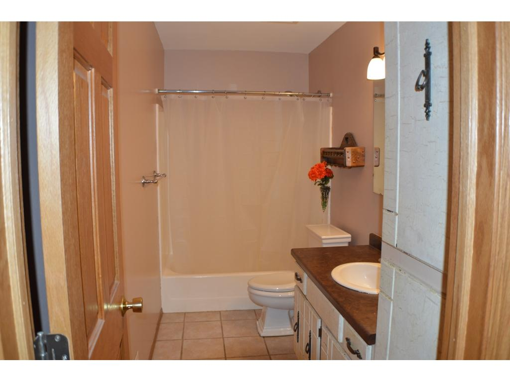 Full bath upstairs with ceramic tile.