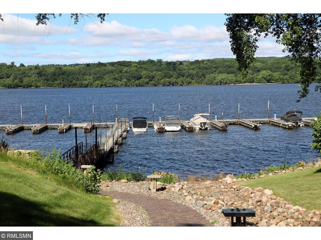 Walk down the brick paved walkway to your boat on the river