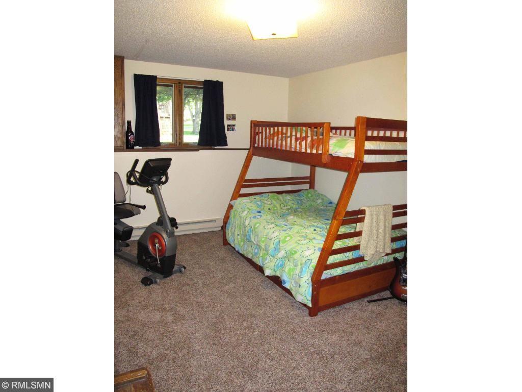 Lower level bedroom with egress windows.