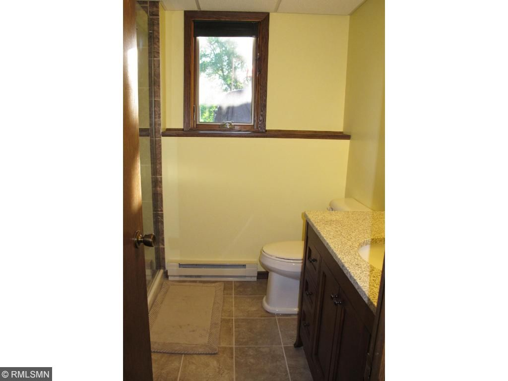 Lower level bath also has new cabinets, flooring and tiled walk in shower.
