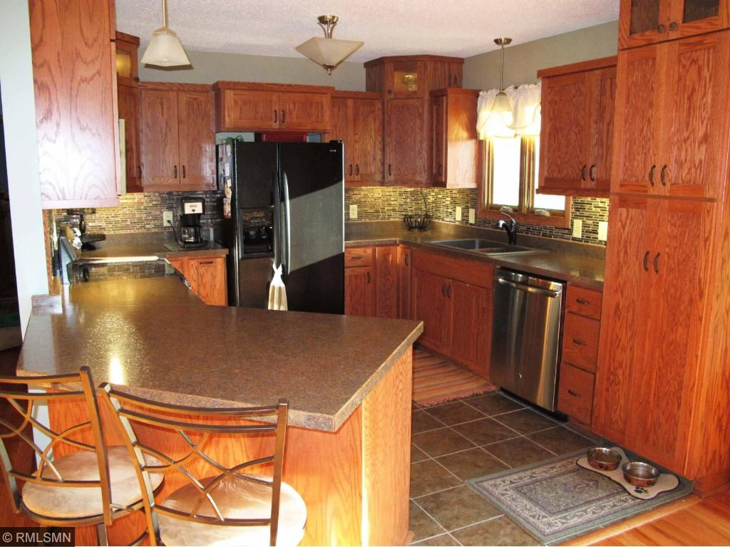 Nicely updated kitchen with custom built oak cabinets and all new appliances.