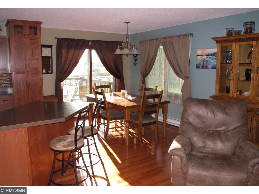Dining area off the kitchen and livingroom with patio doors leading to newly built deck.