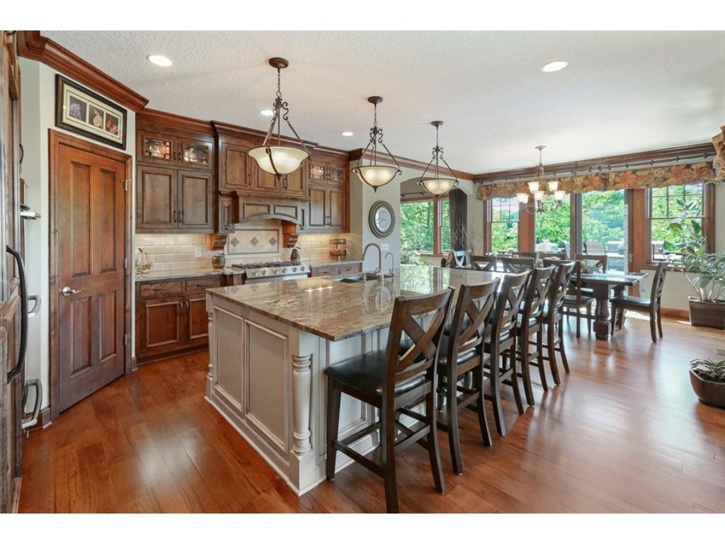 Gleaming, Wide Plank, Natural Hickory Floors Flow From The Foyer, Into The  Great