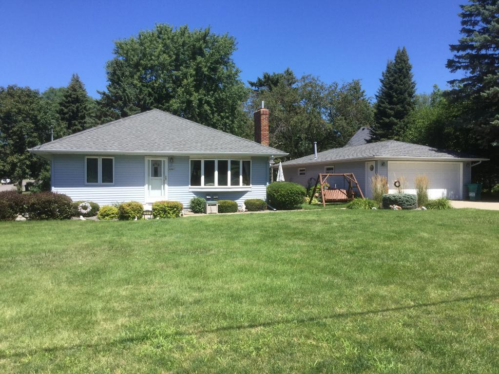 Well-maintained rambler home with 4 car heated-garage and concrete driveway!