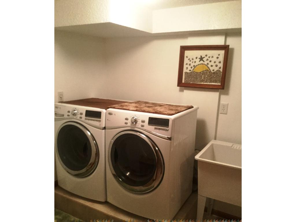... a finished laundry room complete the lower level!