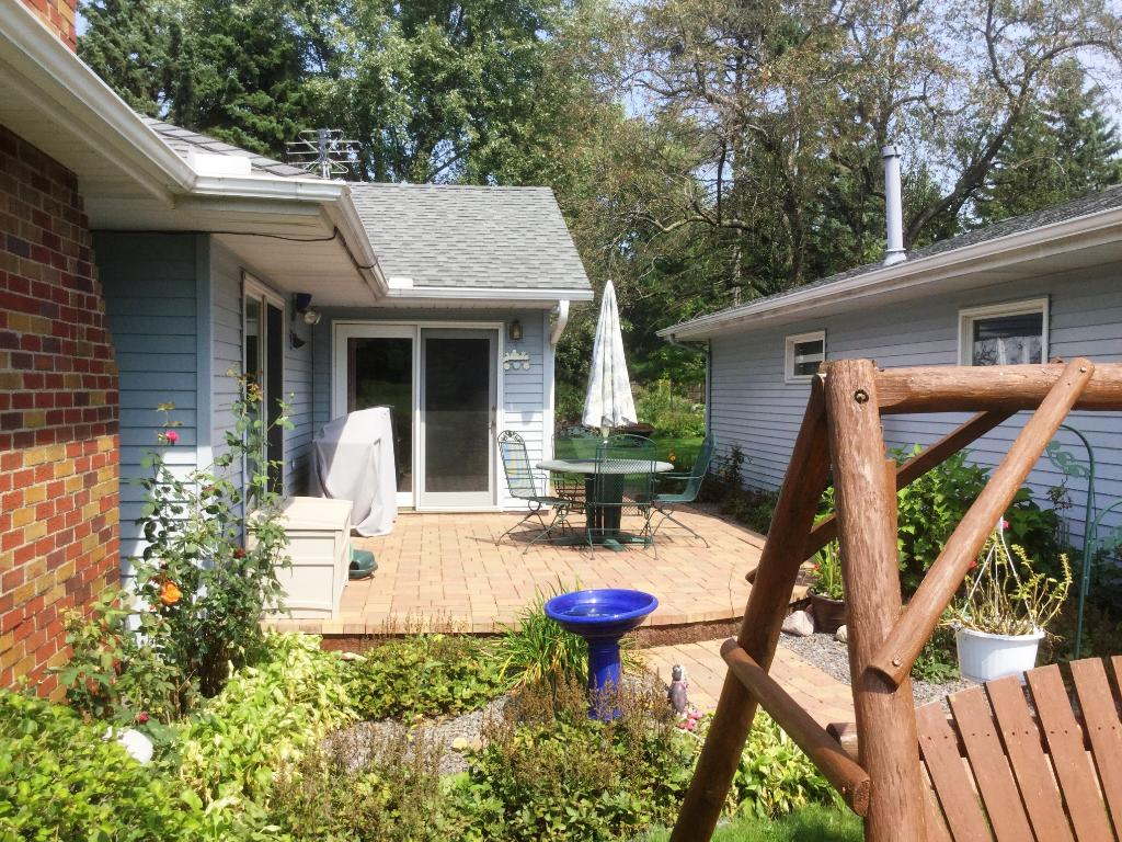 Private, paver patio surrounded by flower garden and shrubs!