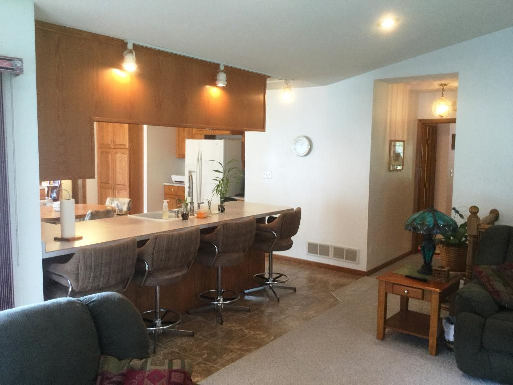 Convenient breakfast bar adjacent to family room area!