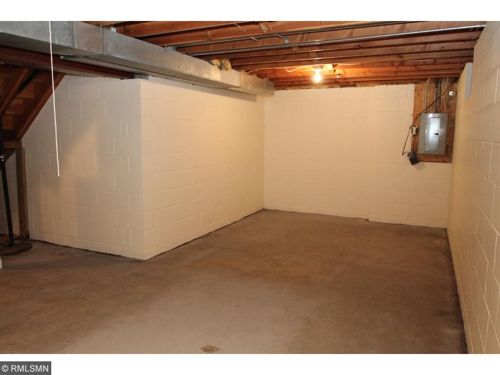 Unfinished basement awaits your ideas.