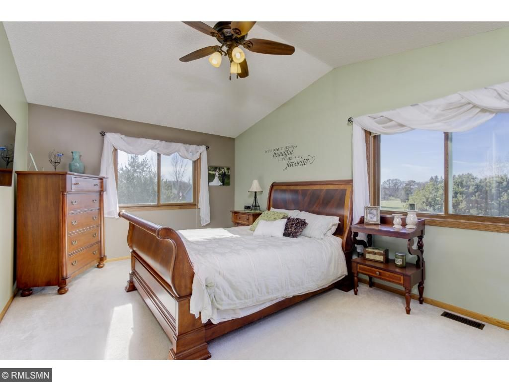 Large master bedroom with lots of natural light, vaulted ceilings and master bath.