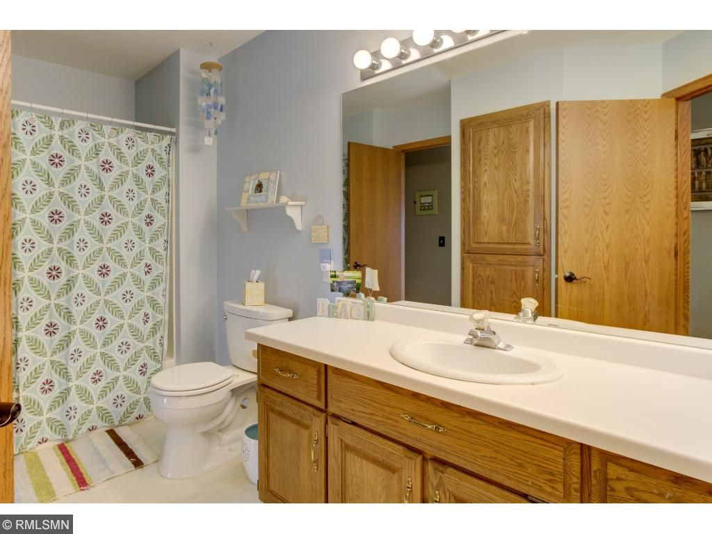 Upper level bathroom with two sinks