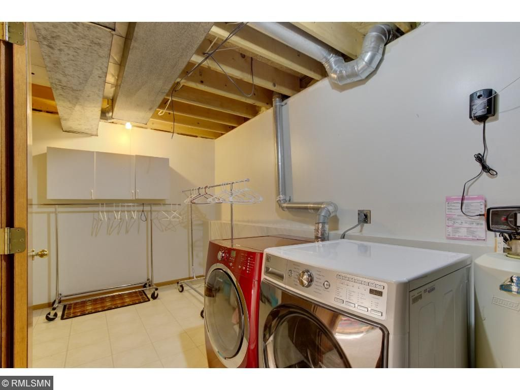 Large laundry room with lots of storage.