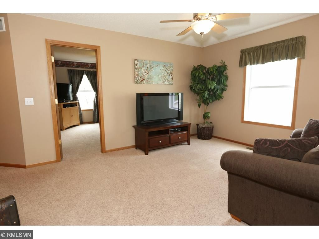 Upper level landing offers another family room area.