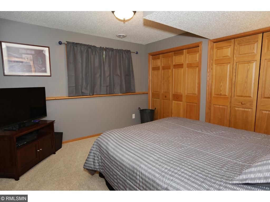 4th bedroom is located on the lower level.  Nice lookout window.  Lots of closet space!