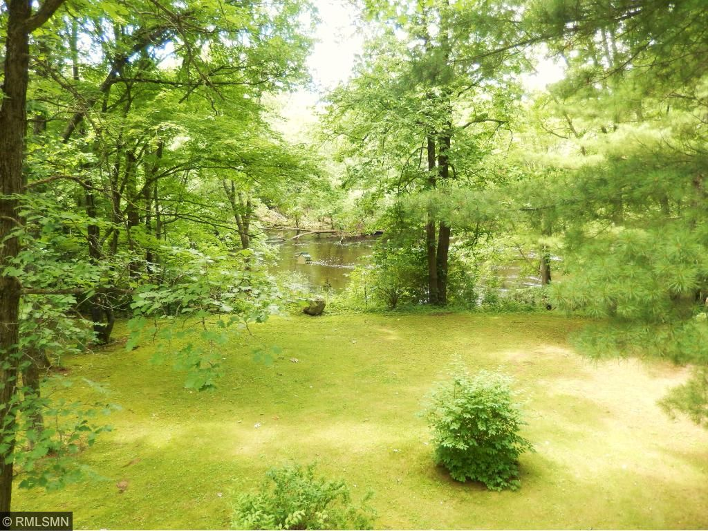 Lots of beautiful perennials on this 1+ acre property.  Just a few steps to the Snake River on this gently sloping lot for great fishing and canoeing!