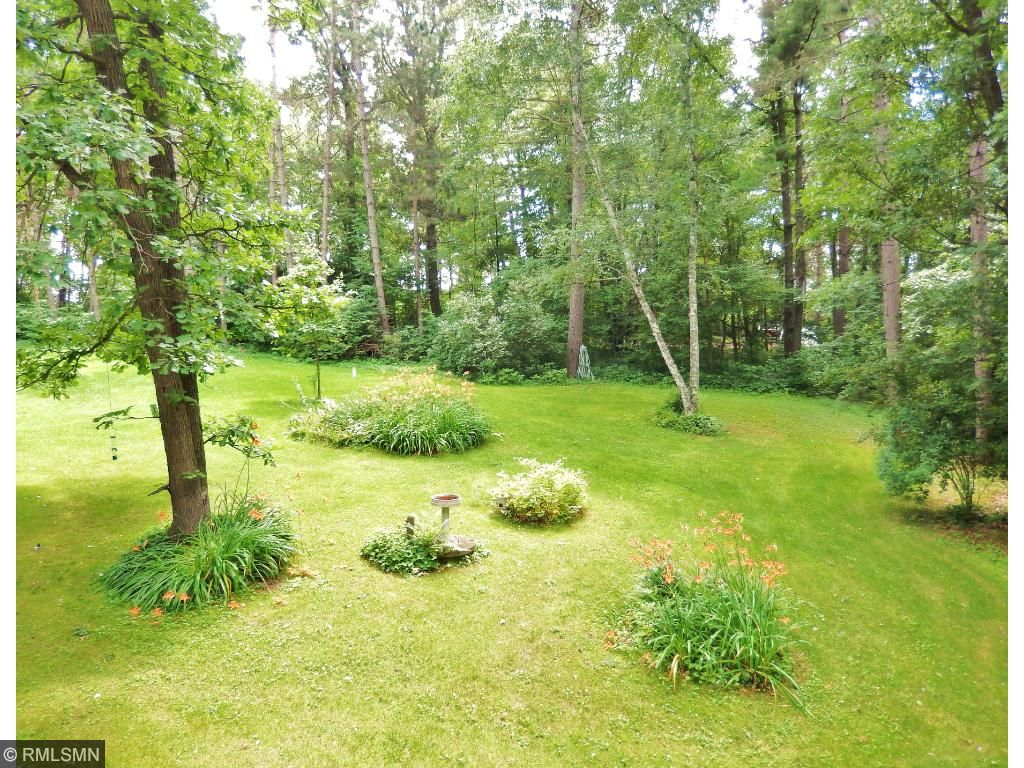 Lots of mature trees, towering pines and beautiful perennials finish off this great property.