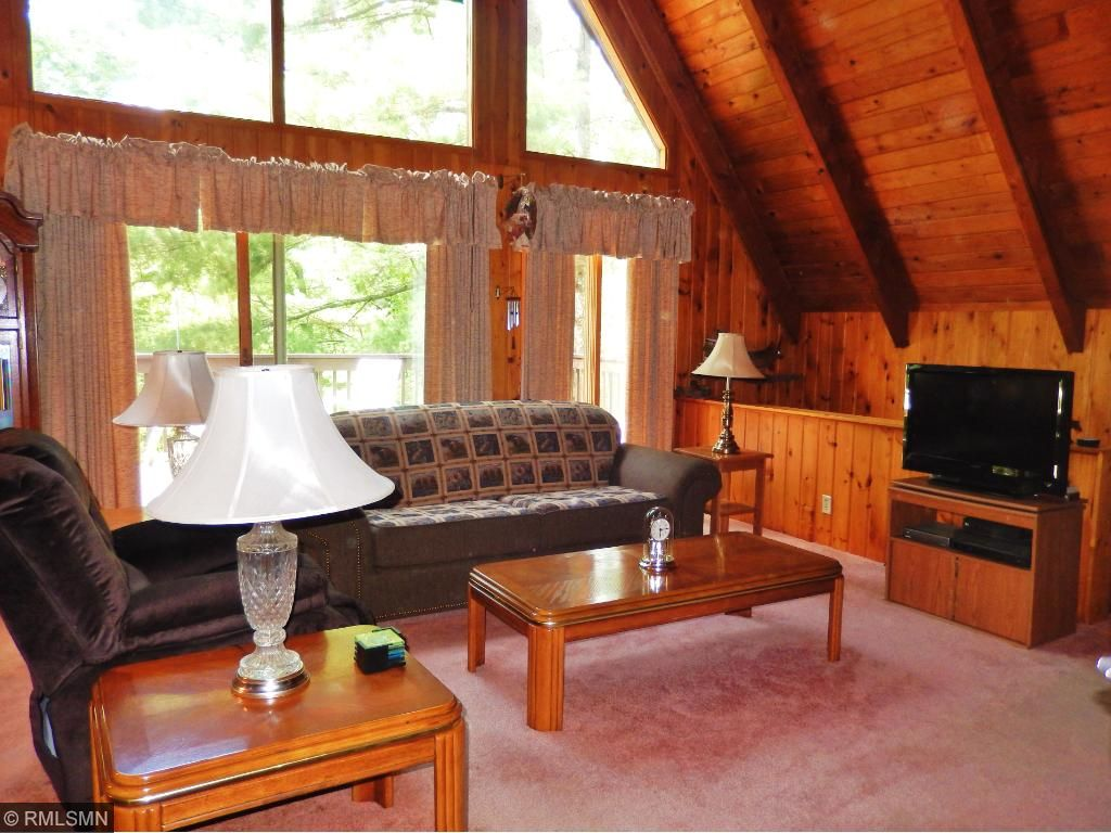 Main floor living room opens up to the dining room and sliding glass doors out on to the deck for your beautiful view of the river.