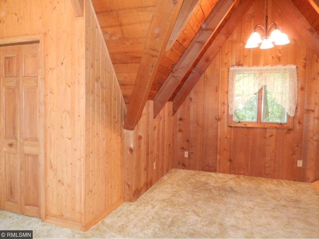 Large upper level bedroom includes a office area and a deck that faces east to enjoy the morning sun and your coffee.