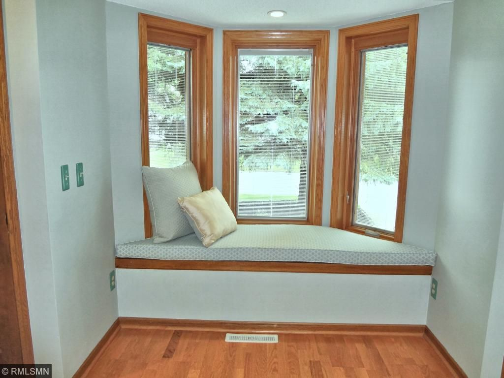 Owner's bay window seating doubles as a place to relax and dressing area.