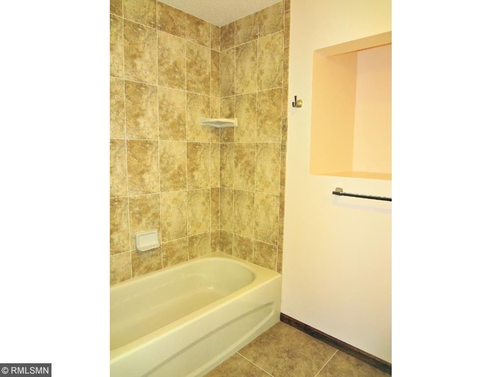Upper level full remodeled guest bath.