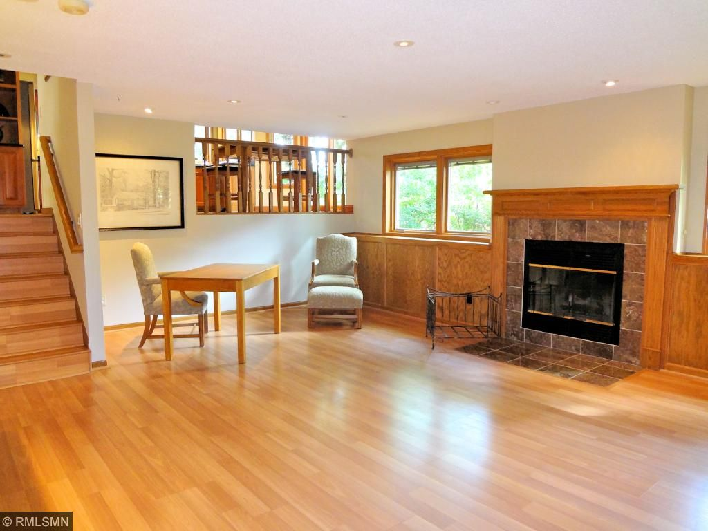 Extra large lower level family room with fireplace and lookout windows is a cozy spot to relax and entertain.