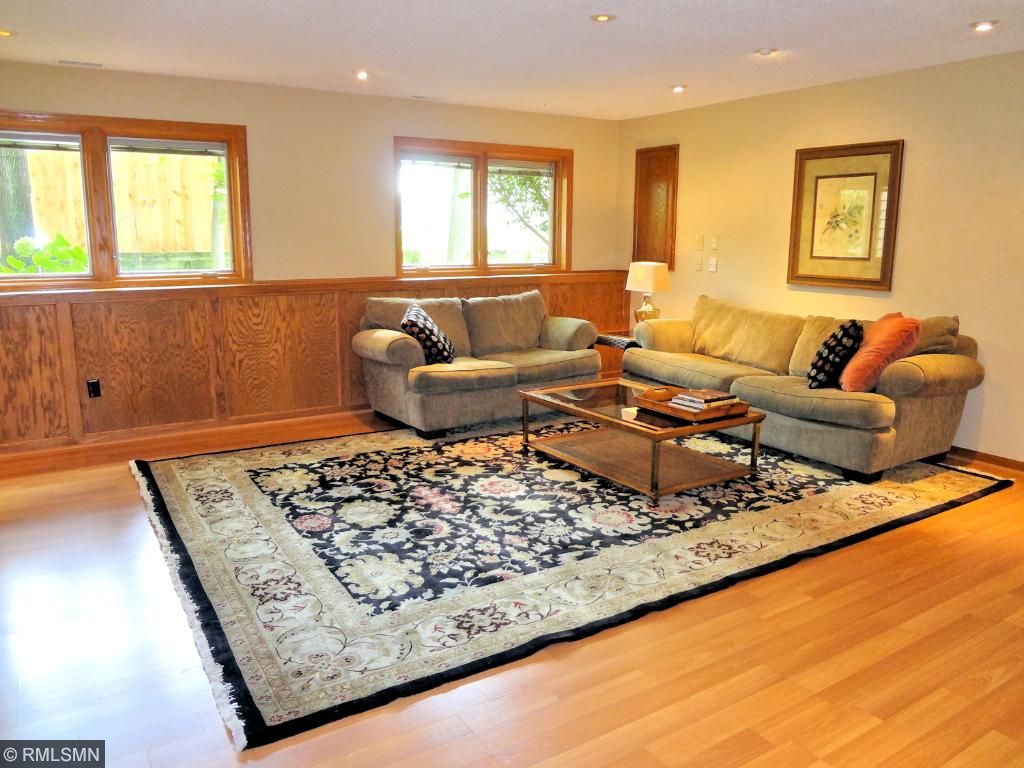 Lower level family room has natural woodwork and plenty of natural light.