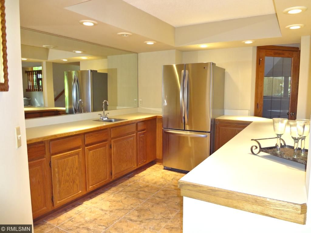 Are you ready for some football? Space to entertain! Wet bar includes a French door LG stainless steel refrigerator.