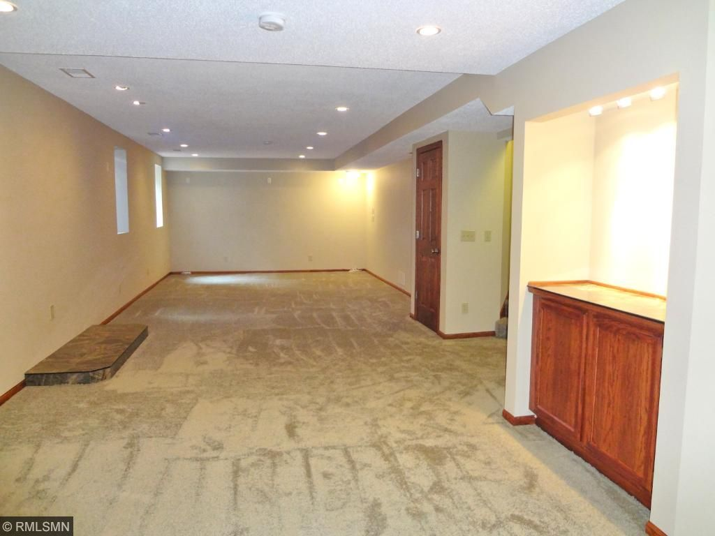 In a lower level off the family room is recreation room that could also double as a very handsome 4th bedroom with egress window.