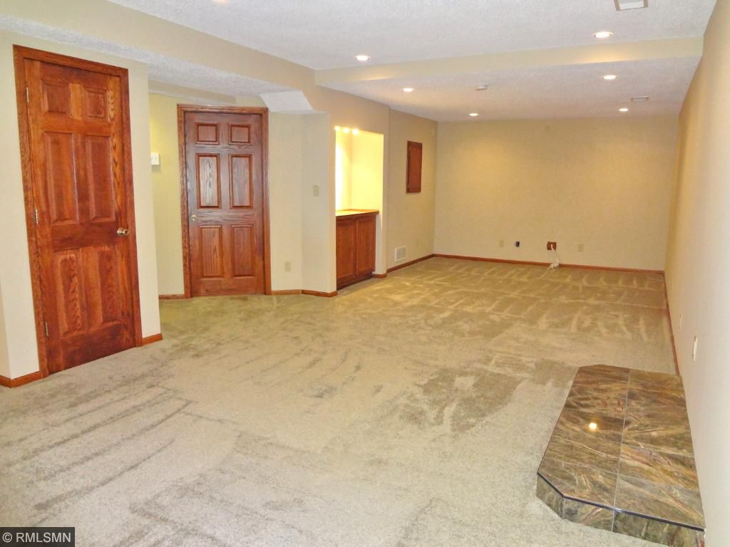 Lower level recreation room is wired for surround sound and 2 TV's and set for an electric fireplace.