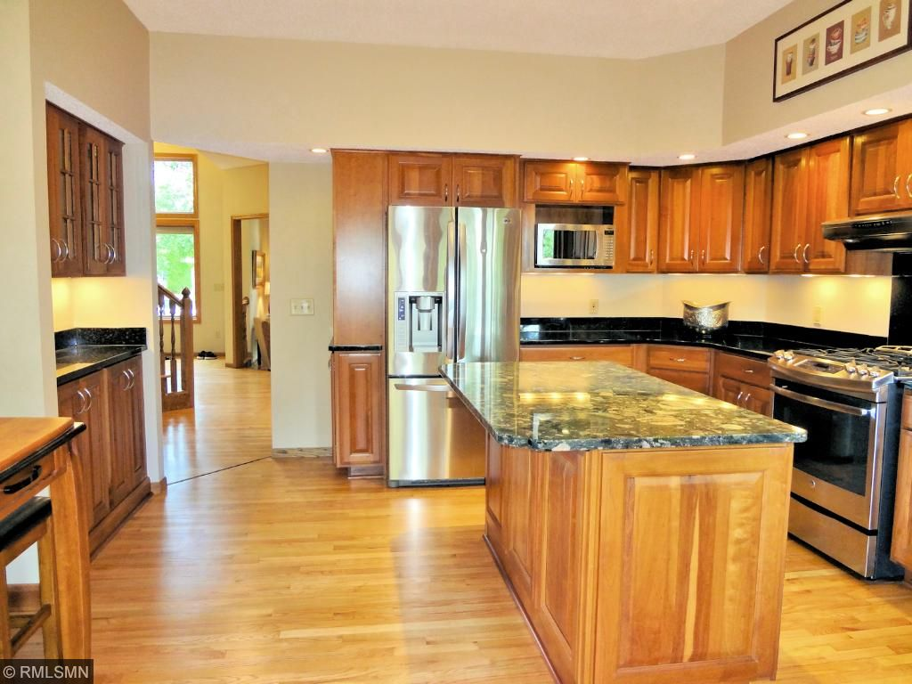 Newer kitchen included stainless steel appliances and under cabinet lighting.
