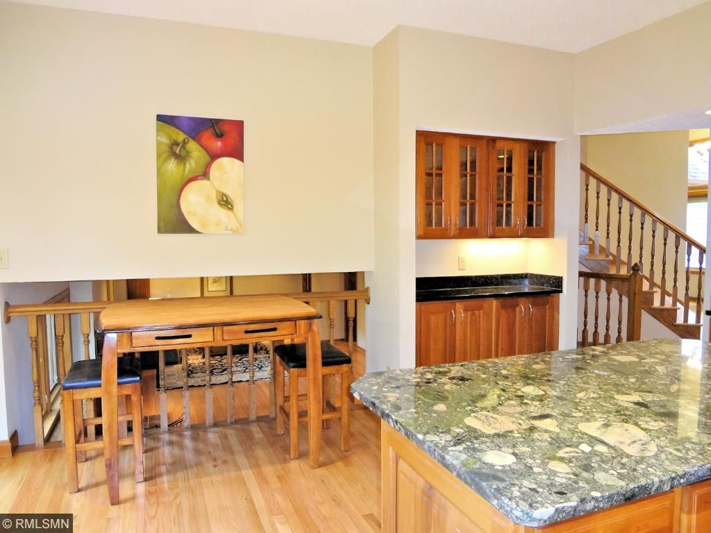 Kitchen offers a waiter's station and eating area overlooking the family room. Ideal for entertaining.