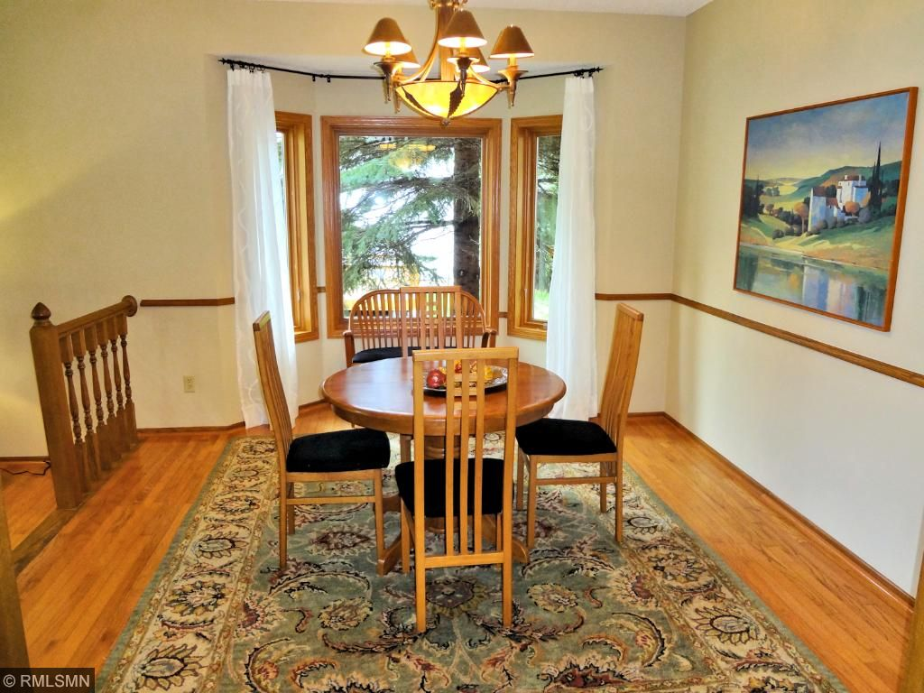 Formal dining room with bay window opens to and connects with the sunken living room.