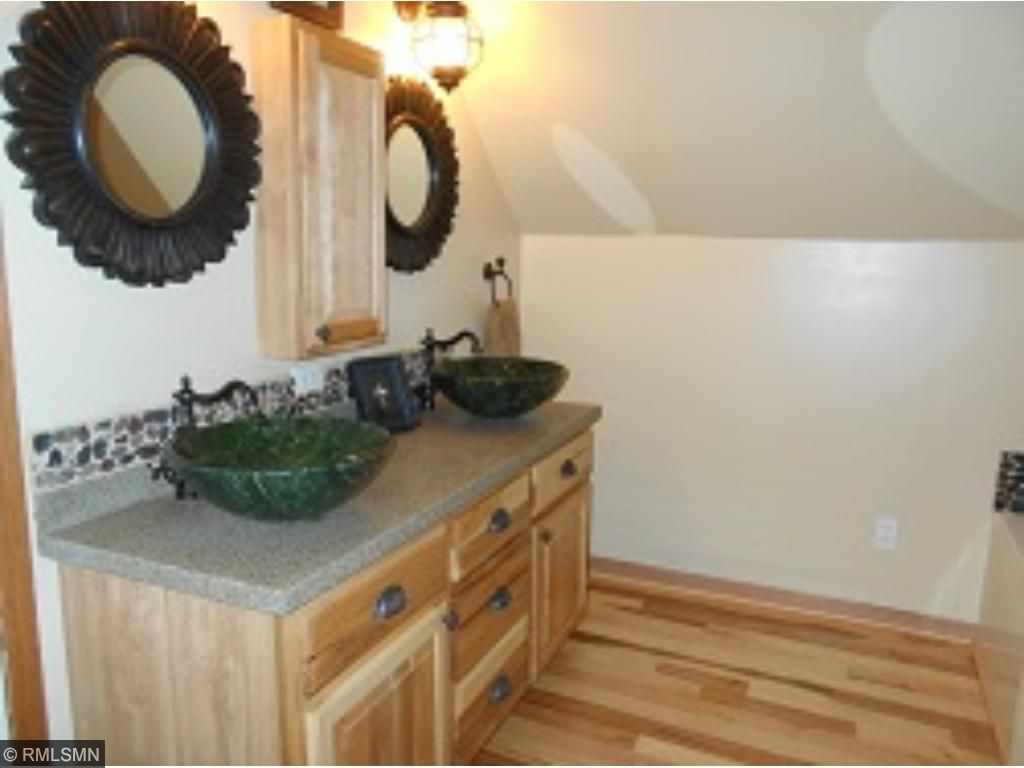 Upstairs Bathroom. with hickory wood flooring, Merillat hickory cabinets & double vessel bowl sinks!