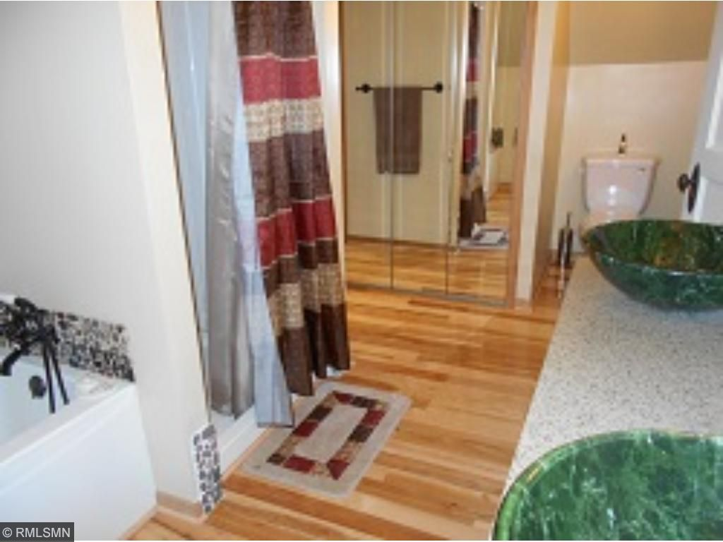 This upstairs bathroom also has a stand alone shower & jetted tub!  Great large walk-in closet is located off of this bathroom.