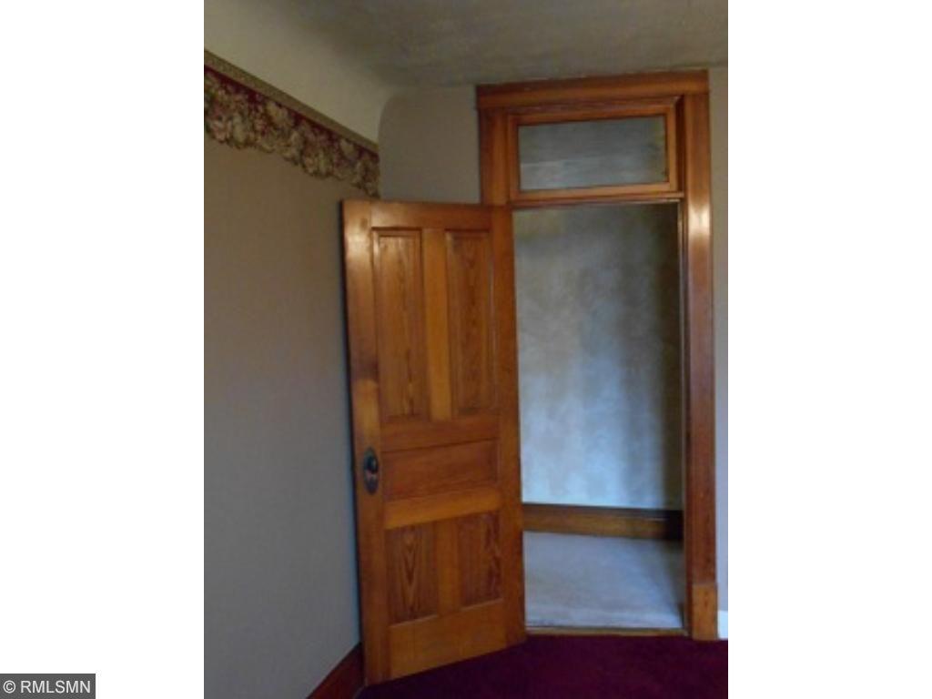 Beautiful Victorian tansom windows on upstairs bedroom doors!