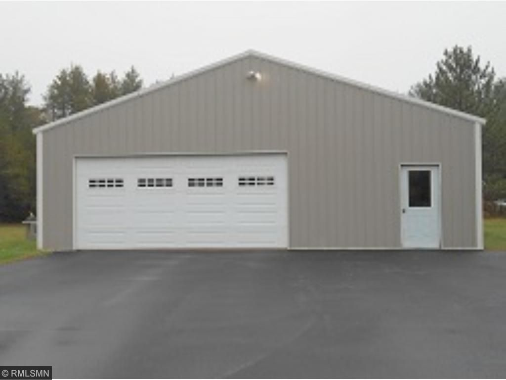 Steel-sided 2+ car garage.  Great for working on your vehicles & storing your recreational toys!  This area of the driveway is also black-topped.