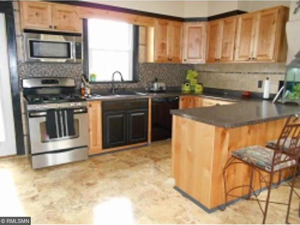 Totally Remodeled Kitchen! Stainless Steel Appliances, Merillat Knotty Alderwood Cabinets, Sink/Faucet Upgrades & High-End Flooring.