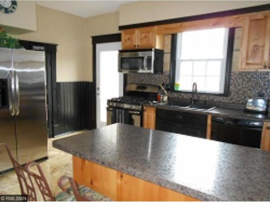 Great kitchen with step-in kitchen pantry and has front porch access off of the kitchen; really makes it convenient for grilling.