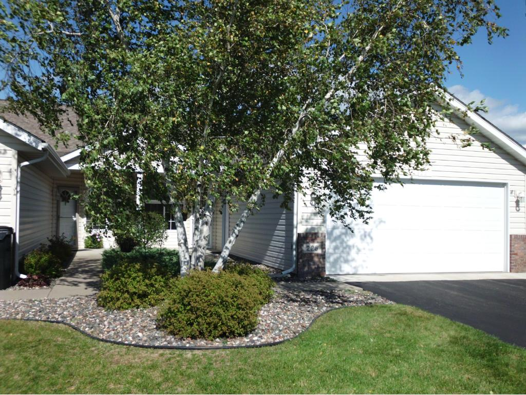 Birch trees welcome you to this one level end unit townhome!