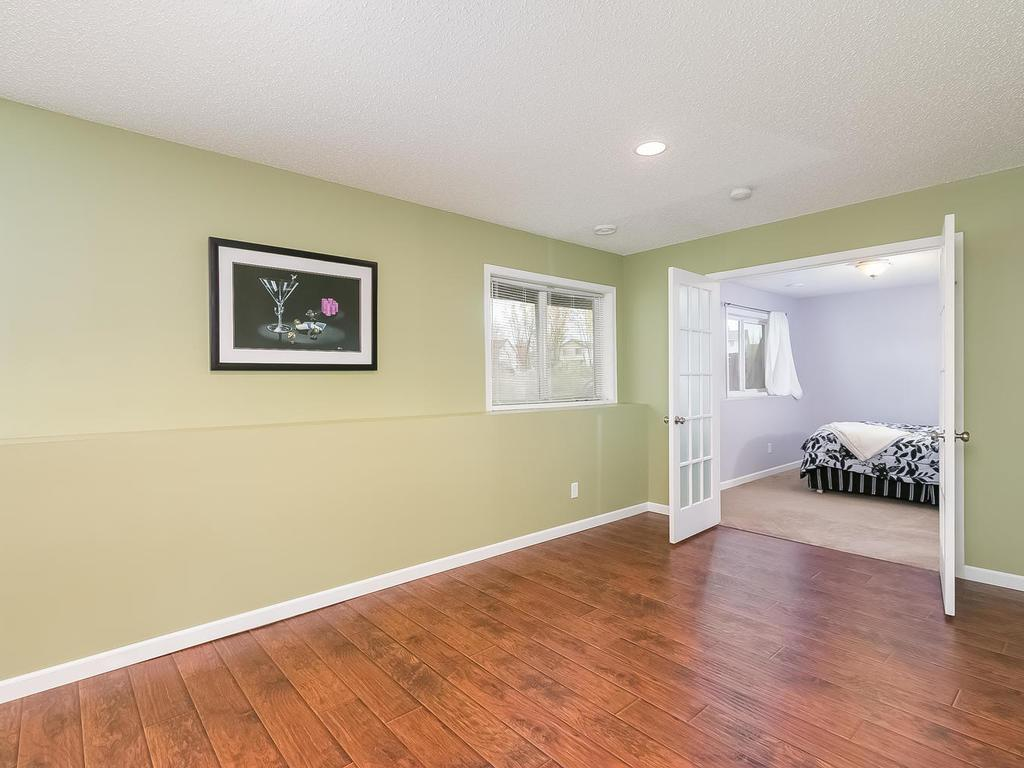 Lower level family room - plenty of room to make it your own.  Bright and cherry with look out windows