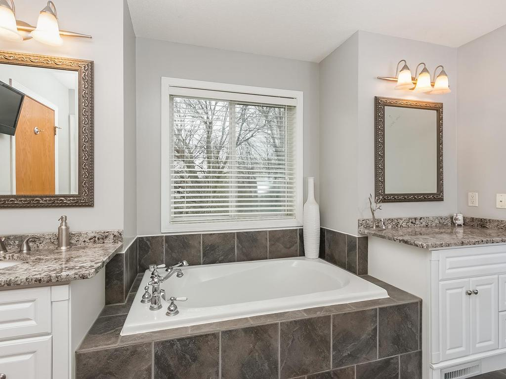 Look at the amazing upgrades with granite and tile in the bath.