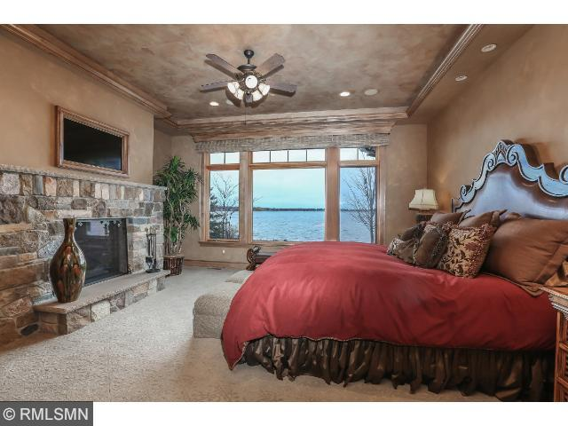 Breakfast nook area with view of lake. Custom built-in cabinets, large window with mechanical blinds.