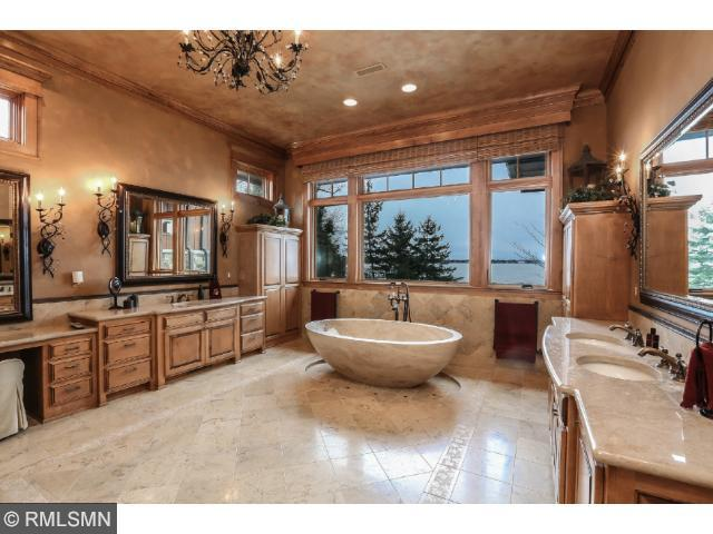 Master suite is a retreat of its own! Stone fireplace, massive walk-in closets, stone soaking tub, 2 water closets, double vanity, steam shower and additional single vanity with attached makeup area.