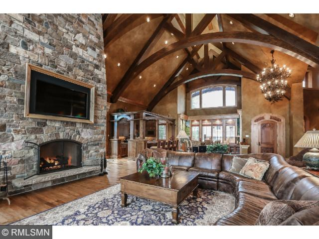 Enter through this custom carved door to a very open floor plan with Vaults and views that are breath taking!